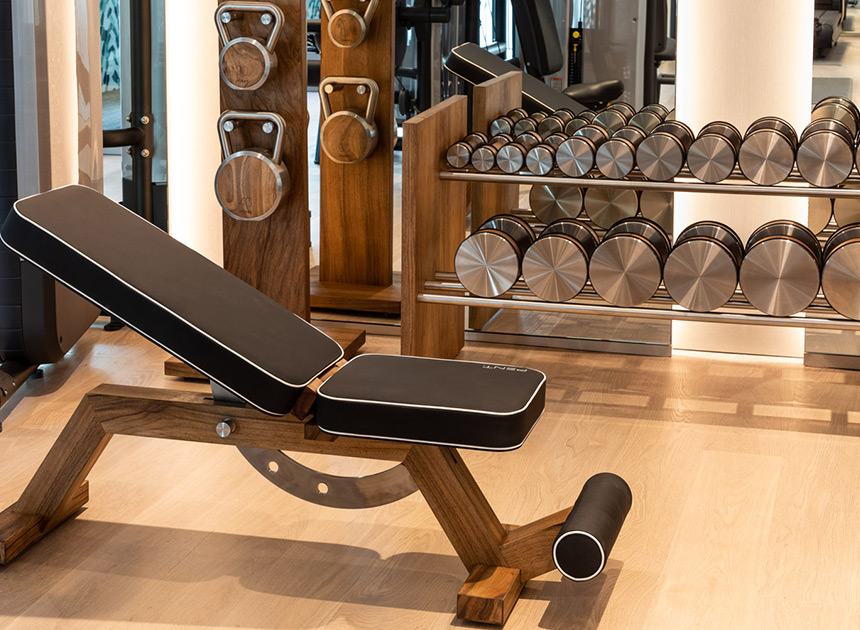 gym with weights and black bench