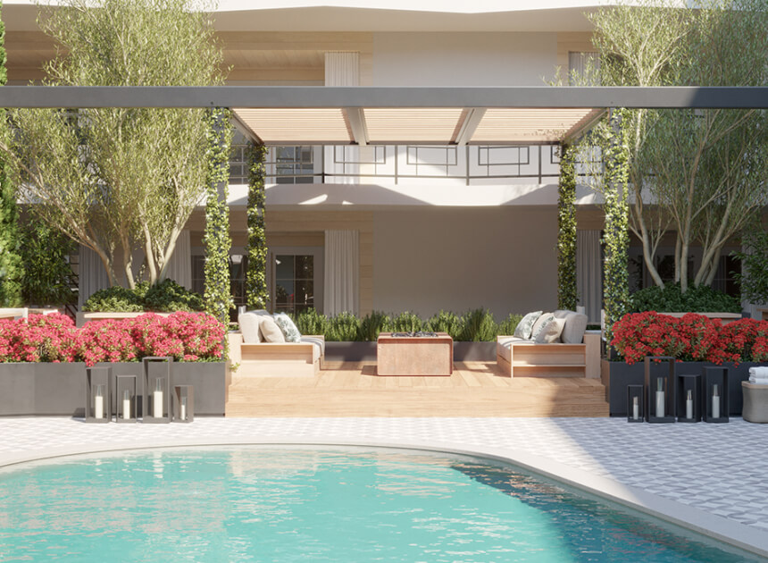 pool area with pots of pink flowers and a covered lounge area with couches