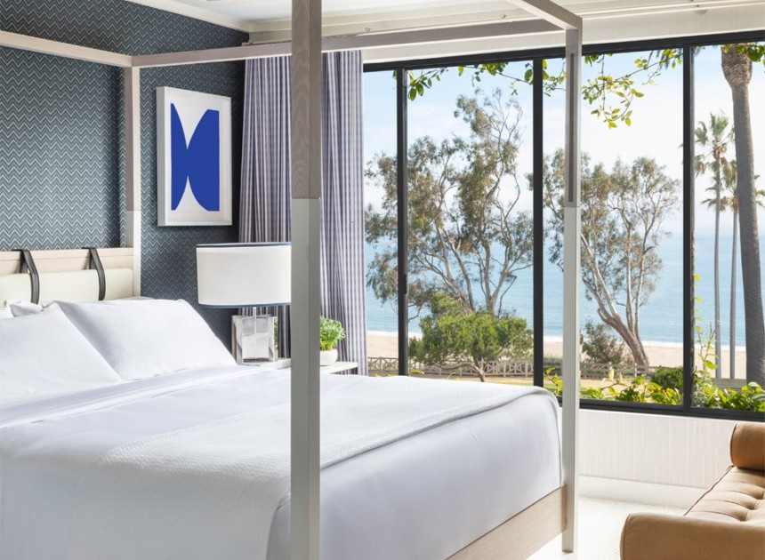 white modern bed in suite with ocean view