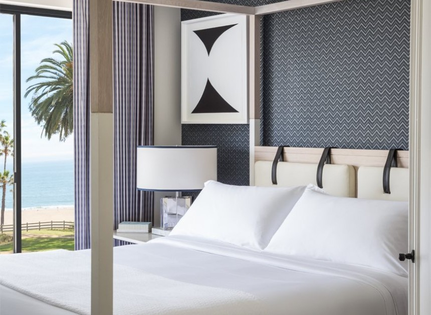 up close shot of modern white bed with ocean view