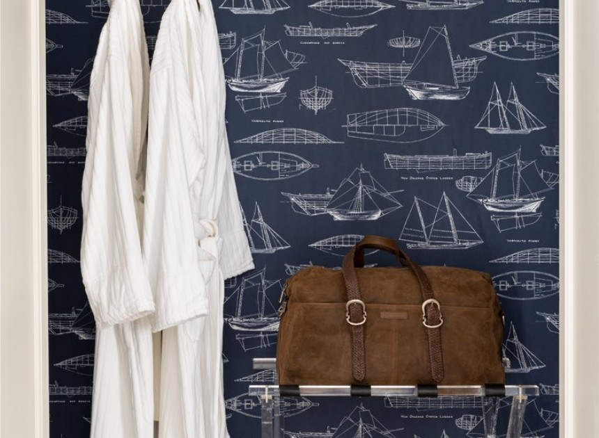 closet view with sailboat wallpaper and two white robes
