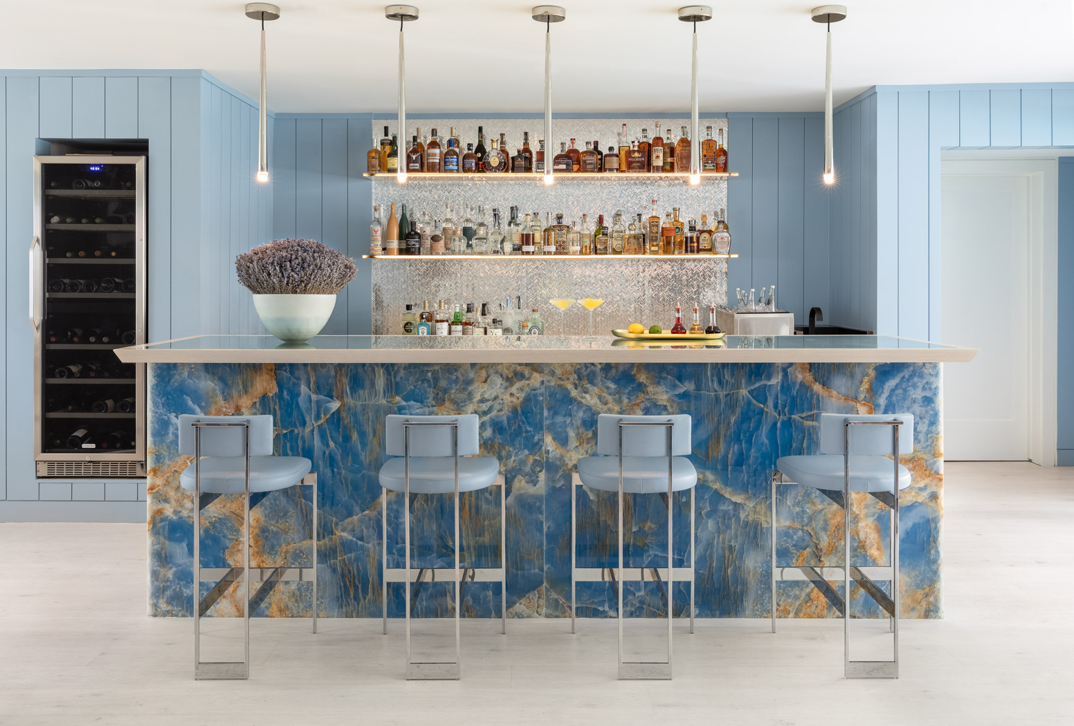 blue bar with barstools and lighting fixtures