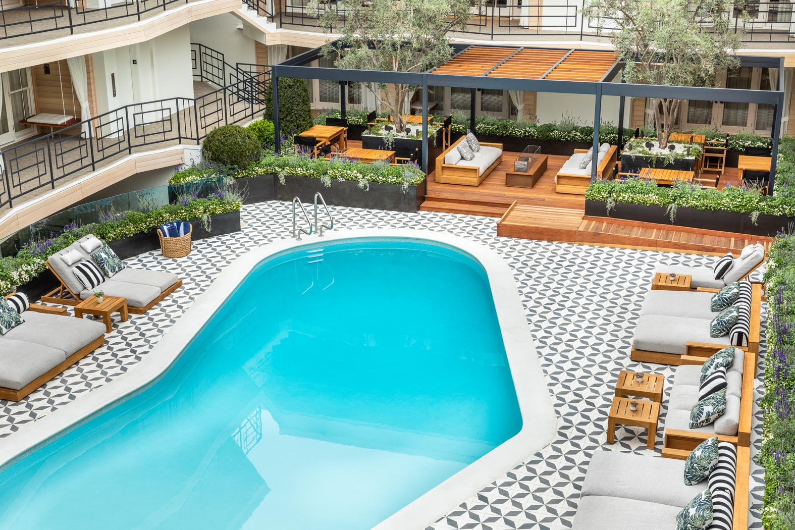 an overhead shot of the pool area next to chairs and a seating area