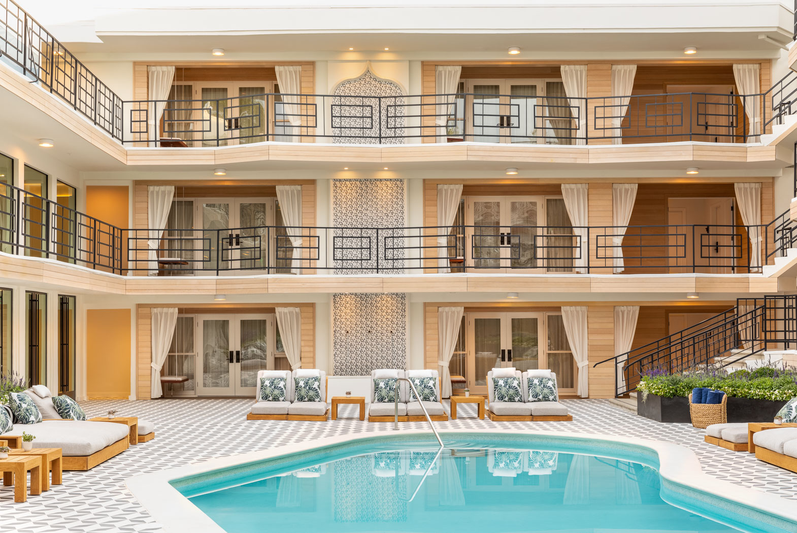 a view of the rooms from the pool area