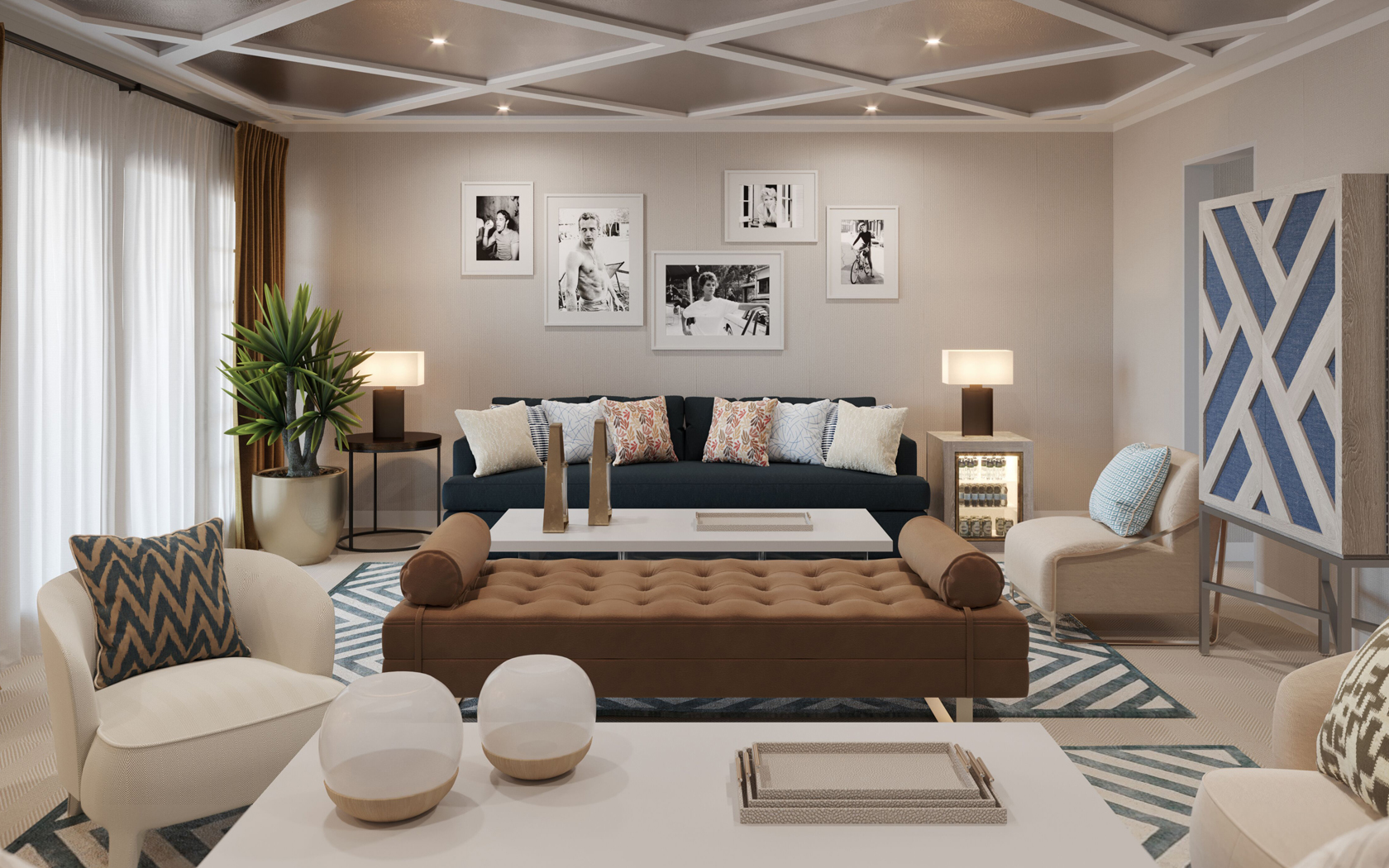 living area with cream and blue furniture and black and white photos on wall