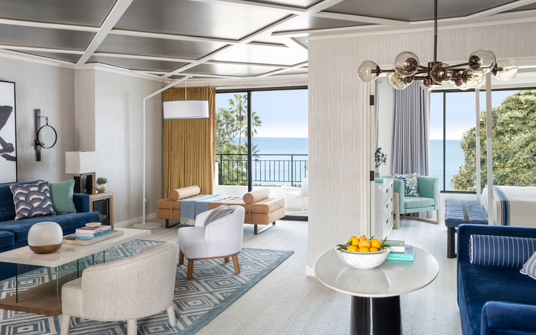 suite with neutral colored furniture and ocean view