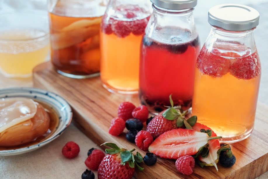 berries and fruit infused beverages in jars