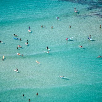 aerial view of surfers in the ocean water
