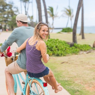 man riding bike with woman sitting on the back