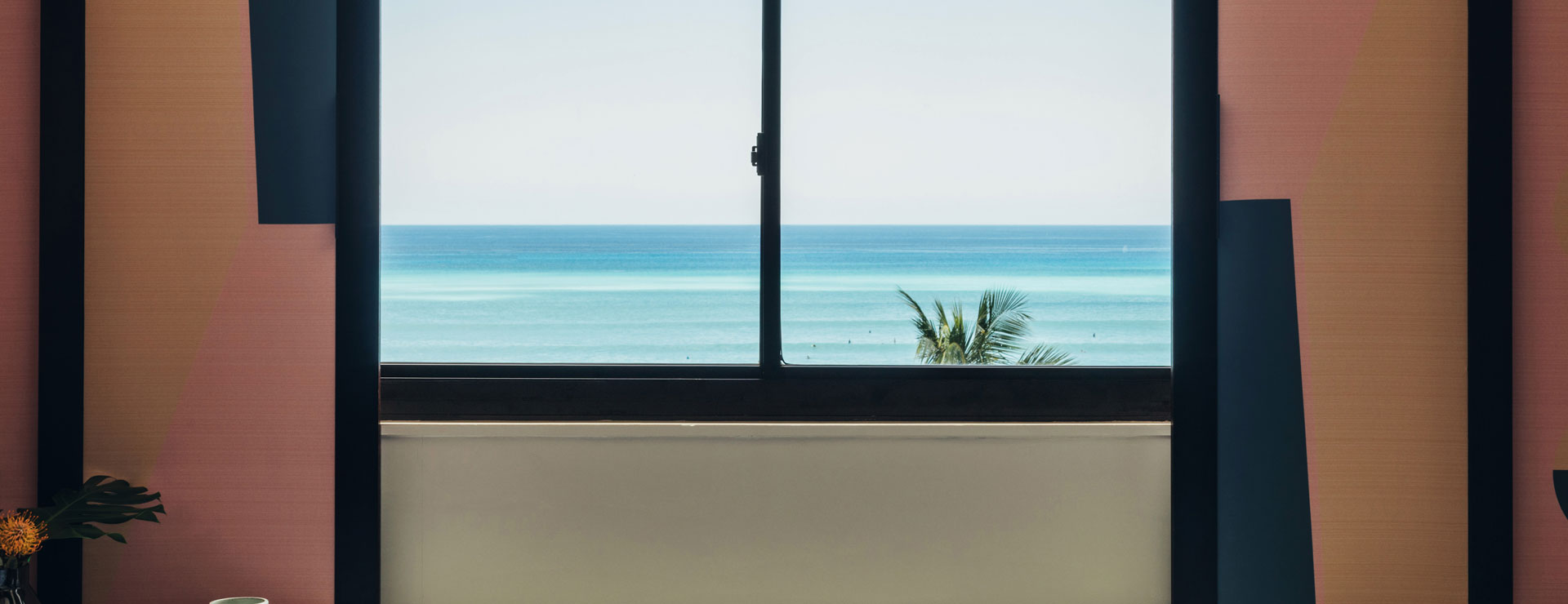 ocean view with pink window shades