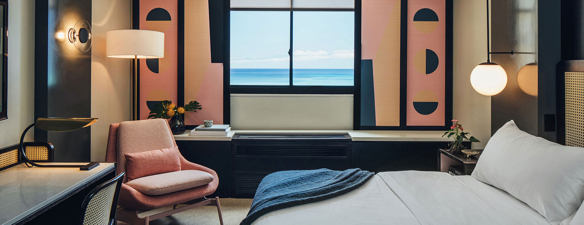 guest room with pink chair and pink window shades