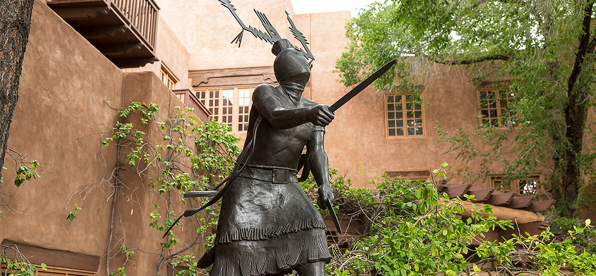 statue of native american warrior