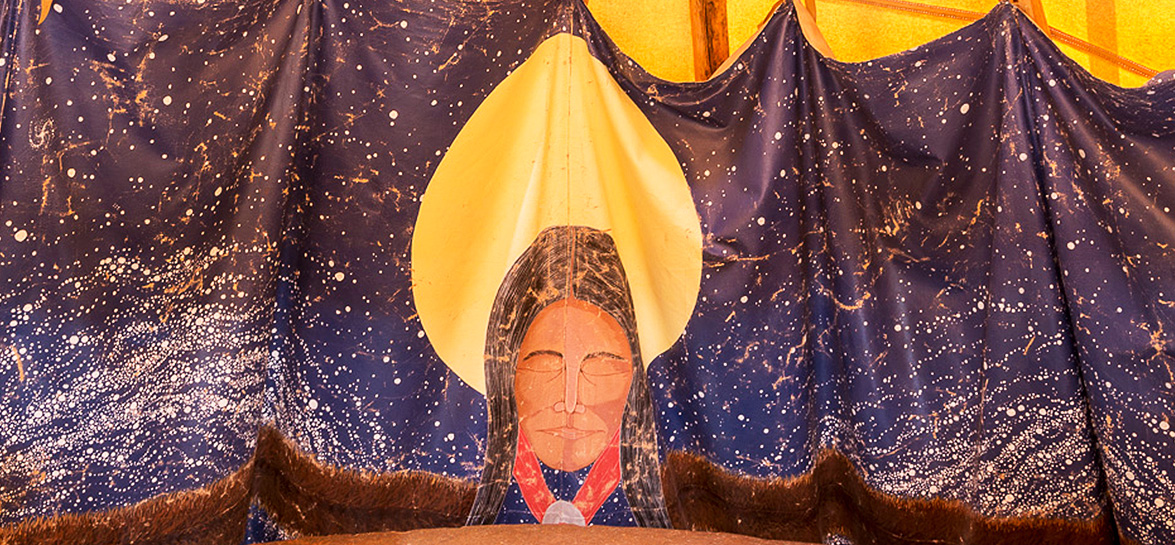 tapestry of native american woman in front of a full moon