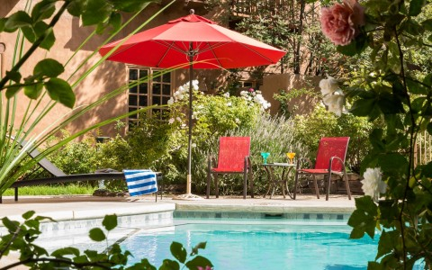 pool patio with red umbrella