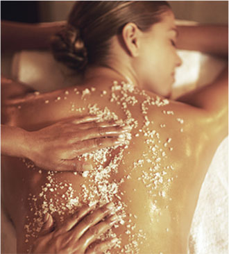 woman receiving a salt massage