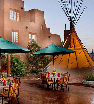 courtyard with tables and a teepee