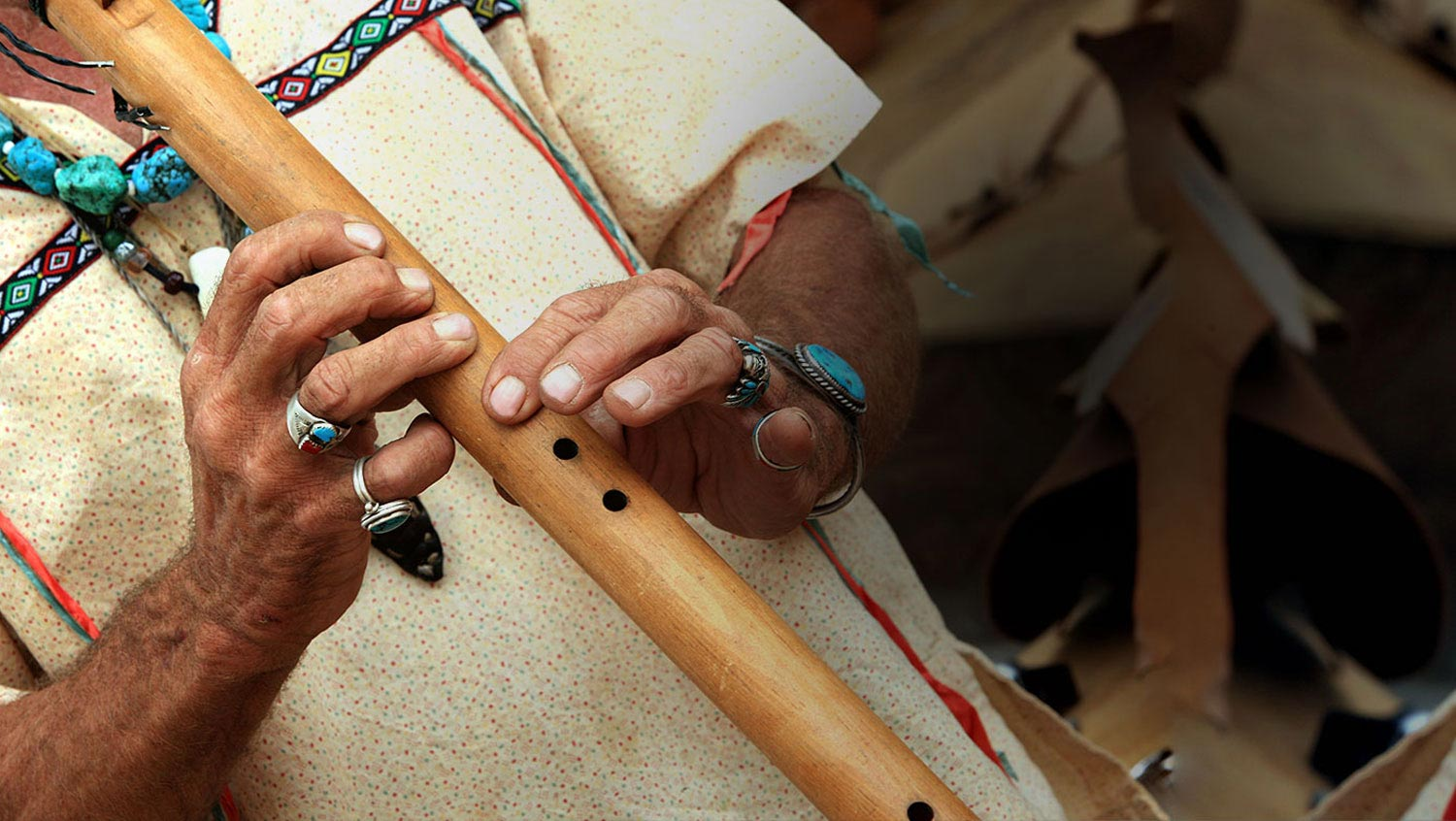 person playing a wooden flute