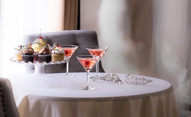 martini cocktails and a tray of desserts on a table