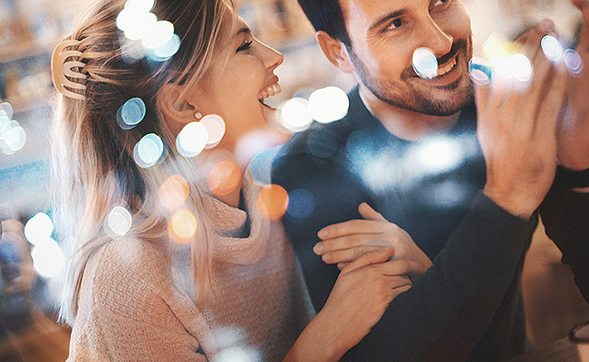 couple laughing with lights shimmering in front of them