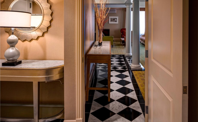 Hallway corridor with black and white marble tile