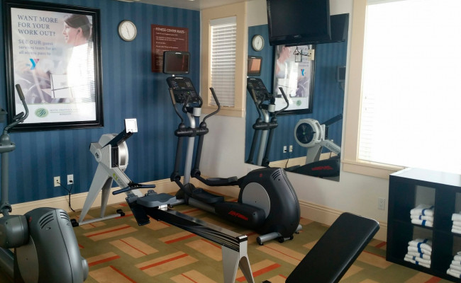 Fitness room with various exercise equipment