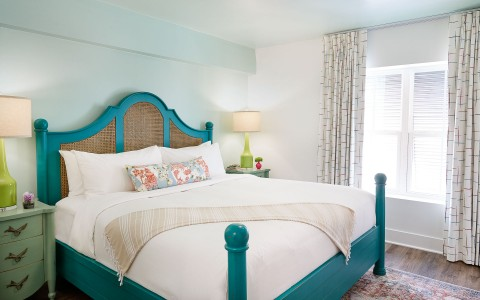 room with teal bed