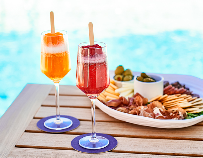 cocktails and appetizers by the pool
