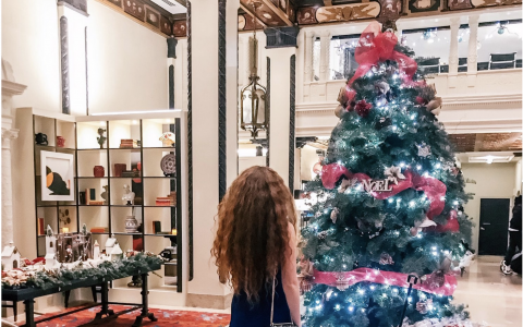 Woman looking at Christmas Tree in hotel lobby