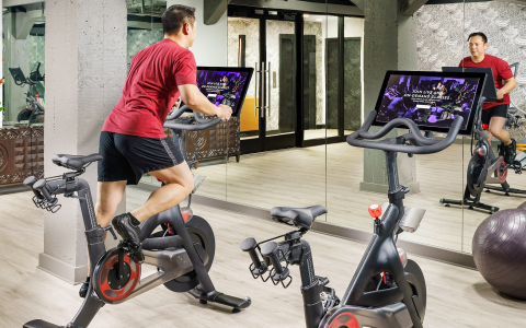 Man on stationary bike in workout room