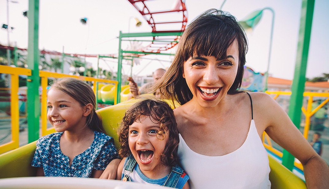 woman and children on roller coaster