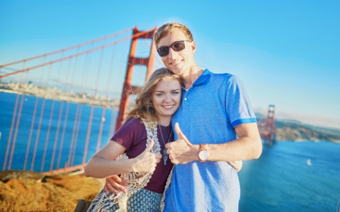couple in front of the golden gate bridge