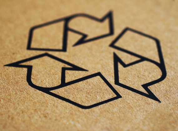 recycle logo printed on a brown background