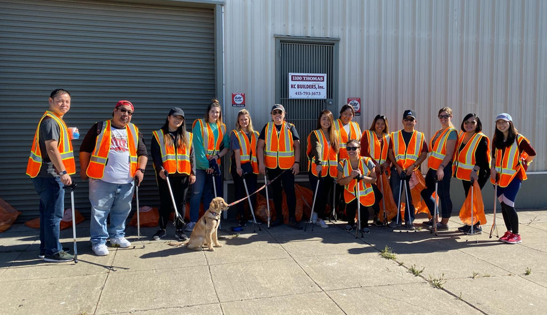 the spero team wearing orange vests standing in front of a storage unit