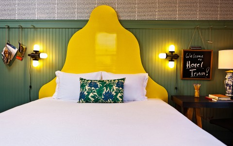 bed with large yellow headboard