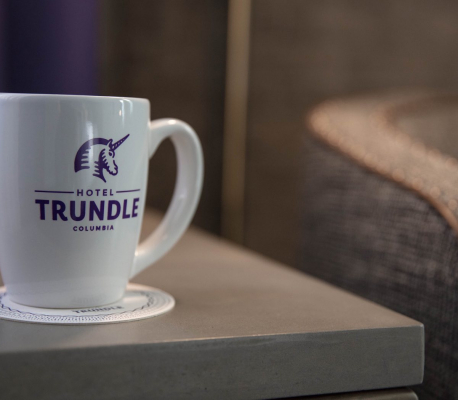hotel trundle coffee cup on side table