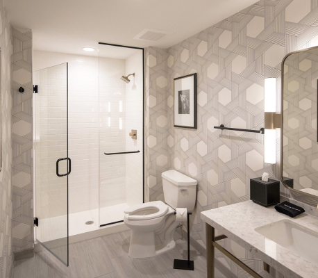 bathroom with grey and white wallpaper