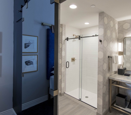 mirror sliding door that leads into bathroom