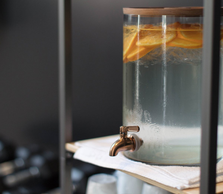 glass jug of water with orange slices inside