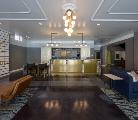 lobby with dark floors and colorful couches