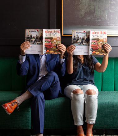 couple holding magazines