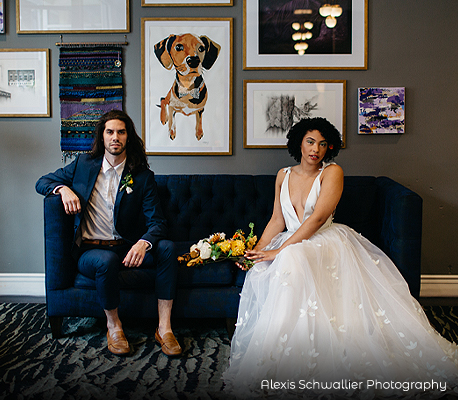 bride and groom posing on a sofa
