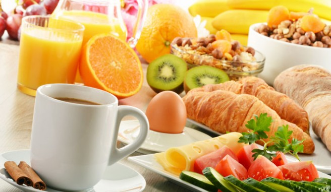 breakfast food displayed on table. Header