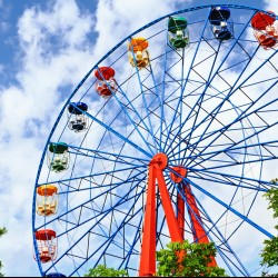 ferris wheel in front of a beautiful blue sky