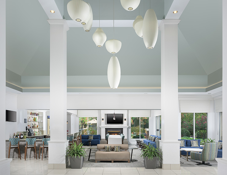 rendering of a hotel lobby with bright lighting and light colored furniture