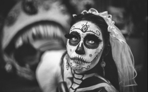 Grayscale Photo of Woman in Day of the Dead Costume