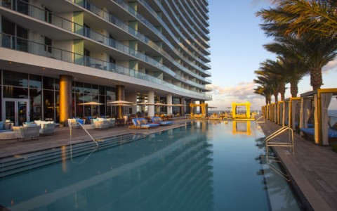 lap pool at Hyde Hollywood Beach surrounded by cabanas, chairs and umbrellas