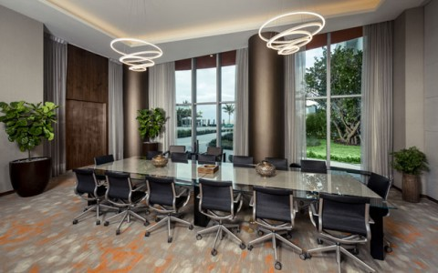 Atlantic Boardroom with long table and chairs, modern chandelier and large windows