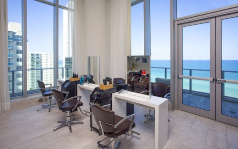 Emena Spa Hair Salon has 3 stations and floor to ceiling windows with doors leading to an ocean view balcony