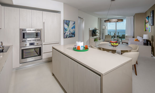 Suite full size kitchen. Full size appliances; sink,over, refridgerator. Large island with 2 stools. Additional table to seat 4. Living room with couch, two chairs and a large balcony over looking the ocean.