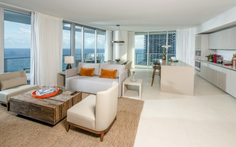 Deluxe Oceanfront at Hyde Hollywood Beach has full sitting area and floor to ceiling sliding doors on a a number of walls with ocean views